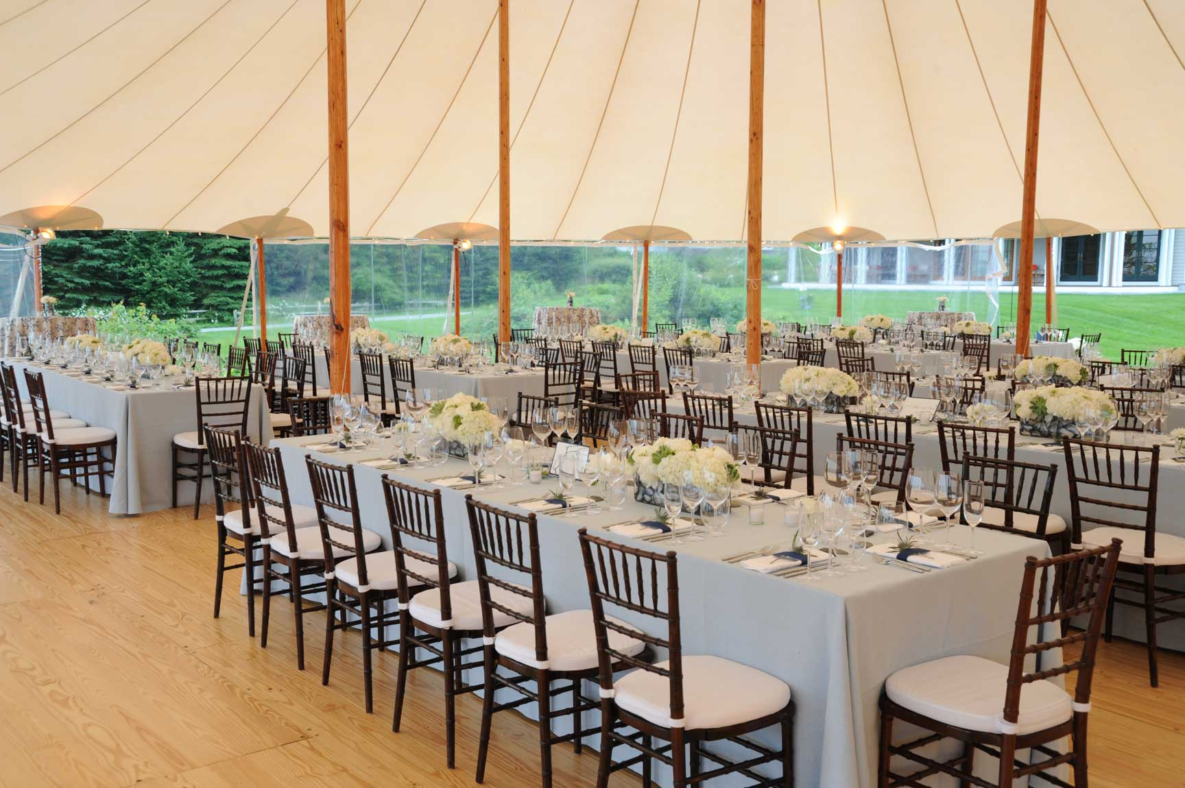 Prouts Neck wedding - White tablescapes and a grandiose tent create a striking backdrop for this Cape Elizabeth wedding. www.churchillevents.com