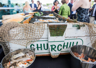 Row boat raw bar at a Churchill Events wedding at Ocean Gateway in Portland Maine. Photo by Peter Greeno Photography